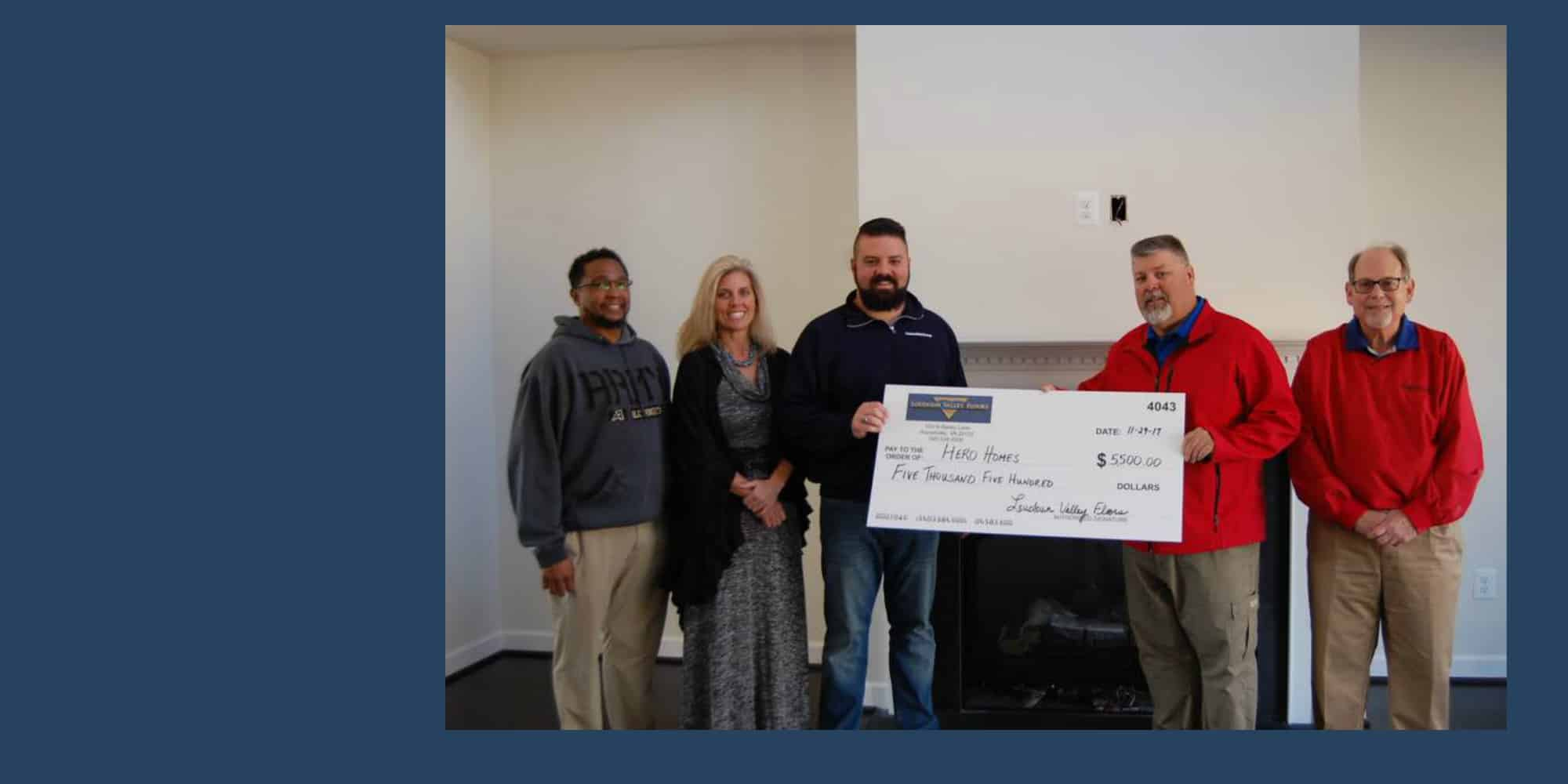 Steve Jacobus of Loudoun Valley Floors presents HeroHomes' Matt Lowers and Liz McDonald with a generous check from their annual fundraiser.