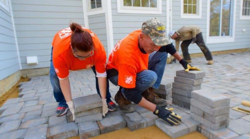 Photo of volunteers laying pavers.